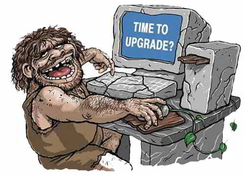 Caveman in front of a computer